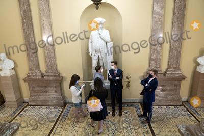 Josh Hawley Photo - United States Senator Josh Hawley (Republican of Missouri) speaks to staff members near the Senate Chamber at the US Capitol in Washington DC US on Thursday March 25 2021 Credit Stefani Reynolds  CNPAdMedia