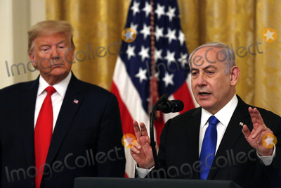 Benjamin Netanyahu Photo - United States President Donald J Trump listens as Israels Prime Minister Benjamin Netanyahu speaks during a meeting in the East Room of the White House in Washington DCon Tuesday January 28 2020 Credit Joshua Lott  CNPAdMedia