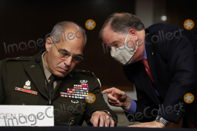 Alabama Photo - United States Senator Doug Jones (Democrat of Alabama) (R) talks with US Army General Gustave Perna during his confirmation hearing to co-lead Operation Warp Speed an effort to find a vaccine for COVID-19 before the US Senate Armed Services Committee in the Dirksen Senate Office Building on Capitol Hill June 18 2020 in Washington DC As the commander of Army Materiel Command Perna will be the chief operating officer of the governments effort to find a safe and effective vaccine for the novel coronavirus Credit Chip Somodevilla  Pool via CNPAdMedia