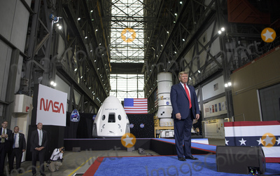 The Interns Photo - In this photo released by the National Aeronautics and Space Administration (NASA) President Donald Trump speaks inside the Vehicle Assembly Building following the launch of a SpaceX Falcon 9 rocket carrying the companys Crew Dragon spacecraft on NASAs SpaceX Demo-2 mission with NASA astronauts Robert Behnken and Douglas Hurley onboard Saturday May 30 2020 at NASAs Kennedy Space Center in Florida NASAs SpaceX Demo-2 mission is the first launch with astronauts of the SpaceX Crew Dragon spacecraft and Falcon 9 rocket to the International Space Station as part of the agencys Commercial Crew Program The test flight serves as an end-to-end demonstration of SpaceXs crew transportation system Behnken and Hurley launched at 322 pm EDT on Saturday May 30 from Launch Complex 39A at the Kennedy Space Center A new era of human spaceflight is set to begin as American astronauts once again launch on an American rocket from American soil to low-Earth orbit for the first time since the conclusion of the Space Shuttle Program in 2011 Mandatory Credit Bill Ingalls  NASA via CNPAdMedia