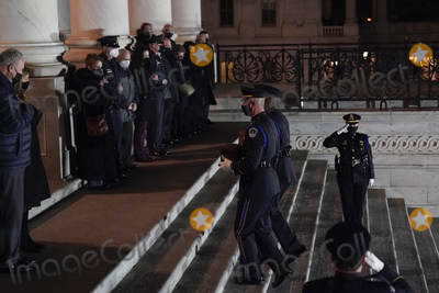 American Flag Photo - An honor guard carries an urn with the cremated remains of US Capitol Police officer Brian Sicknick and a folded American flag up the steps of the US Capitol to lie in honor in the Rotunda Tuesday Feb 2 2021 in Washington as Senate Majority Leader Chuck Schumer of NY and House Speaker Nancy Pelosi of Calif left and the family right watch Credit Alex Brandon  Pool via CNPAdMediaAdMedia