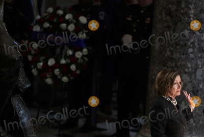 Alex Wong Photo - Speaker of the United States House of Representatives Nancy Pelosi (Democrat of California) speaks during a memorial service for the late US Representative Elijah Cummings (Democrat of Maryland) at the Statuary Hall of the US Capitol October 24 2019 in Washington DC Rep Cummings passed away on October 17 2019 at the age of 68 from complications concerning longstanding health challenges Credit Alex Wong  Pool via CNPAdMedia