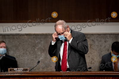 Foreigner Photo - United States Senator Jim Risch (Republican of Idaho) Chairman US Senate Committee on Foreign Relations removes his face mask before testifying at a Senate Committee on Foreign Relations hearing on US Policy in the Middle East on Capitol Hill in Washington DC on September 24 2020 (Erin SchaffThe New York Times)Credit Erin Schaff  Pool via CNPAdMedia