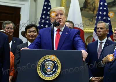 The Used Photo - United States President Donald J Trump makes remarks at the signing ceremony for the US-Japan Trade Agreement and US-Japan Digital Trade Agreement in the Roosevelt Room of the White House in Washington DC on Monday October 7 2019 Photo Credit Ron SachsCNPAdMedia
