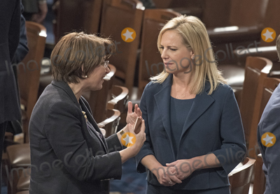 Amy Klobuchar Photo - United States Senator Amy Klobuchar (Democrat of Minnesota) left converses with US Secretary of Homeland Security is Kirstjen Nielsen right as President Donald J Trump departs after delivering his first State of the Union address to a joint session of the US Congress in the US House chamber in the US Capitol in Washington DC on Tuesday January 30 2018 Photo Credit Ron SachsCNPAdMedia