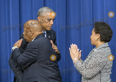 Barack Obama Photo - United States President Barack Obama  center hugs US Representative John Lewis (Democrat of Georgia) left after making remarks at a session hosted by the White House Office of Public Engagement on strengthening and protecting the right to vote at the White House in Washington DC on Thursday August 6 2015 The event was attended by civil rights leaders faith leaders voting rights activists and state and local officials  US Attorney General Loretta Lynch is at rightCredit Ron Sachs  Pool via CNPAdMedia