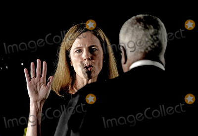 Supremes Photo - Associate Justice of the Supreme Court Clarence Thomas administers the oath of office to Judge Amy Coney Barrett to be Associate Justice of the Supreme Court on the South Lawn of the White House in Washington DC on Monday October 26 2020  Credit Ken CedenoPool via CNPAdMedia