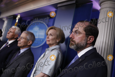 Alex Azar Photo - United States Secretary of Health and Human Services (HHS) Alex Azar right listens during a Coronavirus Task Force news conference in the briefing room of the White House in Washington DC US on Friday March 20 2020 Americans will have to practice social distancing for at least several more weeks to mitigate US cases of Covid-19 Anthony S Fauci of the National Institutes of Health said today Credit Al Drago  Pool via CNPAdMedia