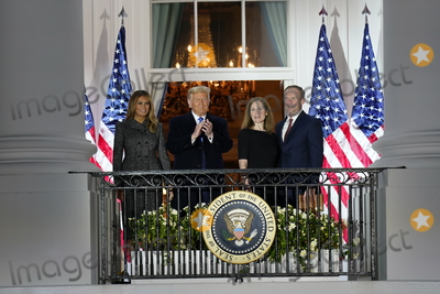 The Ceremonies Photo - United States President Donald J Trump left center and first lady Melania Trump left pose for a photo with Justice Amy Coney Barrett right center and her husband Jesse Barrett right following the ceremonial swearing-in of Justice Barrett as Supreme Court at the White House in Washington DC October 26 2020 Credit Chris Kleponis  Pool via CNPAdMedia