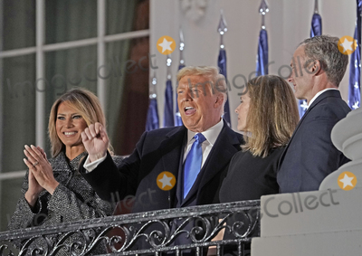 Supremes Photo - United States President Donald J Trump left center gestures to guests as he and Justice Amy Coney Barrett right center pose for photos following the ceremony where she took the oath of office to be Associate Justice of the Supreme Court on the Blue Room Balcony of the White House in Washington DC US October 26 2020 First lady Melania Trump looks on from left and Jesse Barrett look on from rightCredit Ken Cedeno  Pool via CNPAdMedia