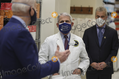 Anthony Fauci Photo - Dr Anthony Fauci director of the National Institute of Allergy and Infectious Diseases listens as President Joe Biden talks duding a visit to the Viral Pathogenesis Laboratory at the National Institutes of Health on Thursday February 11 2021 in Bethesda Maryland Credit Oliver Contreras  Pool via CNPAdMedia