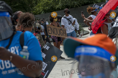 Martin Luther King Jr Photo - People brave the extreme Summer heat to gather at the  Martin Luther King Jr Memorial following the Get Your Knee Off Our Necks March on Washington at the Lincoln Memorial in Washington DC Friday August 28 2020 Credit Rod Lamkey  CNPAdMedia