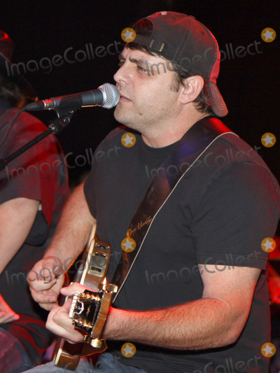 Rhett Akins Photo - August 16 2011 - Athens GA - Rhett Akins Country artist Colt Ford rounded up his songwriter and artist friends to hold a benefit for the family of Elmer Buddy Christian an Athens Police Officer who died in the line of duty  On hand were Jason Aldean Edwin McCain Rhett Akins Dallas Davidson James Otto Rachel Farley Corey Smith Brantley Gilbert and Mike Dekel The performance was held for a packed house at the reconstructed and recently reopened Georgia Theater Photo credit Dan HarrAdMedia