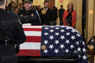 Alex Wong Photo - United States Secretary of Education Betsy DeVos right pays respects to US Representative Elijah Cummings (Democrat of Maryland) as the late congressman lies in state outside the US House chamber at the US Capitol October 24 2019 in Washington DC Rep Cummings passed away on October 17 2019 at the age of 68 from complications concerning longstanding health challengesCredit Alex Wong  Pool via CNPAdMedia