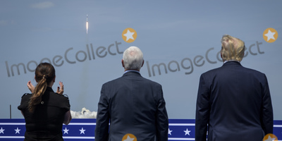 The National Photo - In this photo released by the National Aeronautics and Space Administration (NASA) President Donald Trump right Vice President Mike Pence and Second Lady Karen Pence watch the launch of a SpaceX Falcon 9 rocket carrying the companys Crew Dragon spacecraft on NASAs SpaceX Demo-2 mission with NASA astronauts Robert Behnken and Douglas Hurley onboard Saturday May 30 2020 from the balcony of  Operations Support Building II at NASAs Kennedy Space Center in Florida NASAs SpaceX Demo-2 mission is the first launch with astronauts of the SpaceX Crew Dragon spacecraft and Falcon 9 rocket to the International Space Station as part of the agencys Commercial Crew Program The test flight serves as an end-to-end demonstration of SpaceXs crew transportation system Behnken and Hurley launched at 322 pm EDT on Saturday May 30 from Launch Complex 39A at the Kennedy Space Center A new era of human spaceflight is set to begin as American astronauts once again launch on an American rocket from American soil to low-Earth orbit for the first time since the conclusion of the Space Shuttle Program in 2011 Mandatory Credit Bill Ingalls  NASA via CNPAdMedia