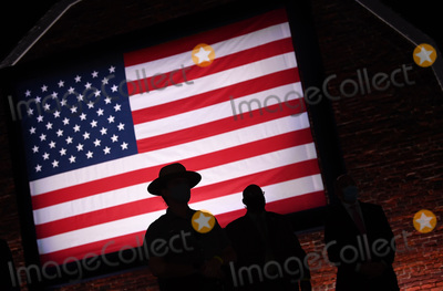 American Flag Photo - A US Park Ranger is silhouetted against the American flag wait on the third night of the Republican Nationals Convention at Ft McHenry in Baltimore Maryland on Wednesday August 26 2020 Credit Kevin Dietsch  Pool via CNPAdMedia
