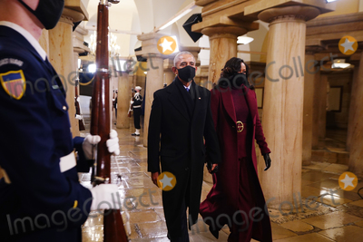 Barack Obama Photo - Former US President Barack Obama (L) and Michelle Obama arrive in the Crypt of the US Capitol for President-elect Joe Bidens inauguration ceremony to be the 46th President of the United States in Washington DC USA 20 January 2021AdMedia