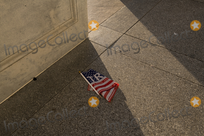 Vandals Photo - Items left on the floor at the entrance of the US Capitol in the aftermath the morning after a riot by pro-Trump supporters who stormed and vandalized the US Capitol as Electoral votes were being counted during a joint session of the United States Congress to certify the results of the 2020 presidential election Washington DC Thursday January 7 2021 Credit Rod Lamkey  CNPAdMedia