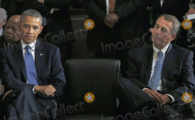 President Obama Photo - United States President Barack Obama left and the current Speaker of the US House John Boehner (Republican of Ohio) right attend a memorial service honoring former Speaker of the US House Thomas S Foley (Democrat of Washington) in the US Capitol in Washington DC on October 29 2013   Foley represented Washingtons 5th Congressional District was the 57th Speaker of the US House of Representatives from 1989 to 1995 He later served as US Ambassador to Japan from 1997 to 2001 US Representative John Lewis (Democrat of Georgia) is at the far left behind President ObamaCredit Aude Guerrucci  Pool via CNPAdMedia
