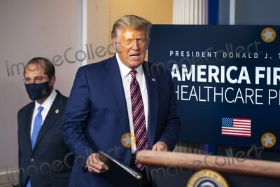 Alex Azar Photo - United States President Donald J Trump arrives to speak to the media about delivering lower prescription drug prices for all Americans in the White House Press Briefing Room in Washington DC USA 20 November 2020  US Secretary of Health and Human Services (HHS) Alex Azar follows at leftCredit Jim LoScalzo  Pool via CNPAdMedia