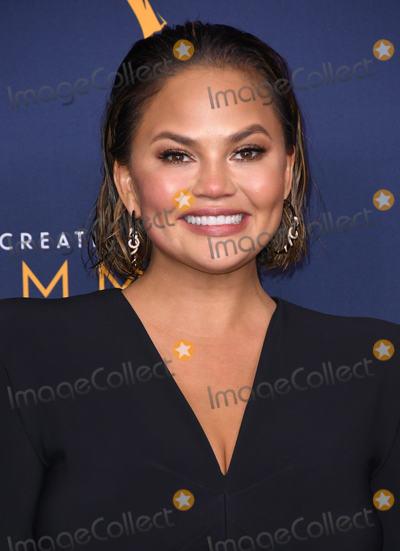 Chrissy Teigen Photo - 09 September 2018 - Los Angeles California - Chrissy Teigen 2018 Creative Arts Emmy Awards - Press Room held at Microsoft Theater Photo Credit Birdie ThompsonAdMedia