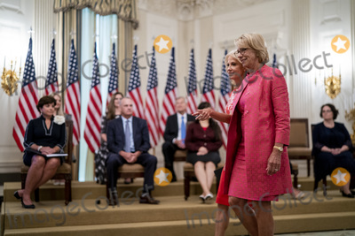Devo Photo - United States Secretary of Education Betsy DeVos and Senior Counselor Kellyanne Conway arrive ahead of President Donald Trump as he participates in Kids First Getting Americas Children Safely Back to School event in the East Room of the White House  Wednesday Aug 12  2020 Credit Doug Mills  Pool via CNPAdMedia