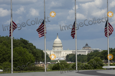 American Flag Photo - The United States Capitol is seen from the Washington Monument in Washington DC US on Saturday May 23 2020  United States President Donald J Trump ordered American flags to be flown at half-staff until May 24 2020 to honor the victims of COVID-19  Credit Stefani Reynolds  CNPAdMedia