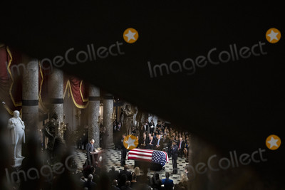 American Flag Photo - United States House Majority Leader Steny Hoyer (Democrat of Maryland) left speaks near the American flag-draped casket of US Representative Elijah Cummings (Democrat of Maryland) during a memorial service in National Statuary Hall at the US Capitol in Washington DC US on Thursday Oct 24 2019 Cummings a key figure in Democrats impeachment inquiry and a fierce critic of US President Donald J Trump died at the age of 68 on October 17 due to complications concerning long-standing health challenges Credit Al Drago  Pool via CNPAdMedia