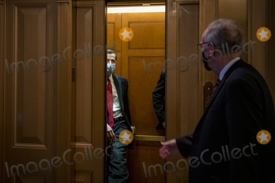 Jerry Moran Photo - United States Senator John Barrasso (Republican of Wyoming) left holds open an elevator for United States Senator Jerry Moran (Republican of Kansas) right outside the Senate chamber as the third day of the Senate impeachment trial of former President Donald Trump is adjourned for the day at the US Capitol in Washington DC Thursday February 11 2021 Credit Rod Lamkey  CNPAdMedia