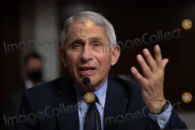 Anthony Fauci Photo - Anthony Fauci director of National Institute of Allergy and Infectious Diseases at NIH testifies during a Senate Health Education and Labor and Pensions Committee on Capitol Hill in Washington Wednesday October 23 2020Credit Graeme Jennings  Pool via CNPAdMedia