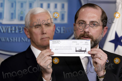 Alex Azar Photo - US Health and Human Services (HHS) Secretary Alex Azar holds 100000 Q4 salary check donated to HHS by President Donald Trump to fight coronavirus during a press conference with Vice President Mike Pence and members of the Coronavirus Task Force at the White House in Washington on March 3 2020Credit Yuri Gripas  Pool via CNPAdMedia