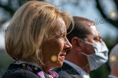 Devo Photo - United States Secretary of Education Betsy DeVos listens as US President Donald J Trump gives an update on the Nations Coronavirus Testing Strategy in the Rose Garden of the White House September 28 2020 in Washington DC  Credit Ken Cedeno  Pool via CNPAdMedia