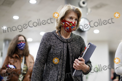 Lisa Murkowski Photo - Senator Lisa Murkowski a Republican from Alaska wears a protective mask while walking through the Senate Subway at the US Capitol in Washington DC US on Thursday Feb 11 2021 House prosecutors used the second day of Donald Trumps impeachment trial to detail a months-long campaign by the former president to stoke hatred and encourage violence over the election results that they said culminated in the mob attack on the US Capitol that he then did little to stop Credit Ting Shen - Pool via CNPAdMedia