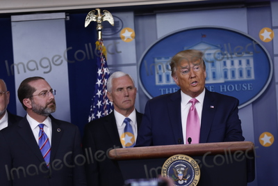 Alex Azar Photo - United States President Donald J Trump delivers remarks during a news conference in the James S Brady Briefing Room of the White House in Washington DC US on Wednesday February 26 2020  Trump joined by members of the Coronavirus Task Force including United States Secretary of Health and Human Services (HHS) Alex Azar left and United States Vice President Mike Pence center attempted to lessen concerns over the Coronavirus after health officials told lawmakers that it is seemingly inevitable that the disease will spread in the United StatesCredit Stefani Reynolds  CNPAdMedia