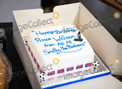 Cake Photo - Photo Must Be Credited Alpha Press 073074 19062020Prince William Duke of Cambridge is presented with a birthday cake by shop owner Paul Brandon during a visit to Smiths the Bakers in the High Street in Kings Lynn Norfolk No UK Rights Until 28 Days from Picture Shot Date