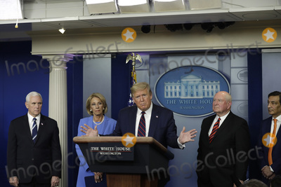 Devo Photo - United States President Donald J Trump during a press briefing on the Coronavirus COVID-19 pandemic with members of the Coronavirus Task Force at the White House in Washington DC on March 27 2020  Standing behind the President from left to right US Vice President Mike Pence US Secretary of Education Betsy DeVos US Secretary of Agriculture Sonny Perdue and Panera Bread CEO Niren ChaudharyCredit Yuri Gripas  Pool via CNPAdMedia