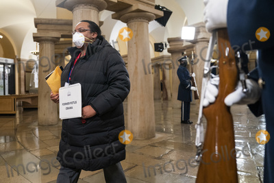 Barack Obama Photo - A woman portraying former President Barack Obama walks through the Capitol crypt during an inauguration rehearsal in the US Capitol in Washington DC USA 18 January 2021 Biden will be sworn-in as the 46th president on 20 JanuaryCredit Jim LoScalzo  Pool via CNPAdMedia