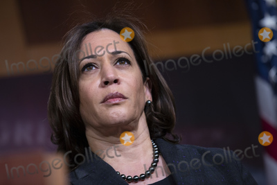 Booker Photo - United States Senator Kamala Harris (Democrat of California) listens during a news conference at the United States Capitol in Washington DC US on Thursday March 12 2020  Harris along with United States Senator Kirsten Gillibrand (Democrat of New York) and United States Senator Cory Booker (Democrat of New Jersey) is working on legislation that would ensure paid sick leave to deal with the Coronavirus  Credit Stefani Reynolds  CNPAdMedia
