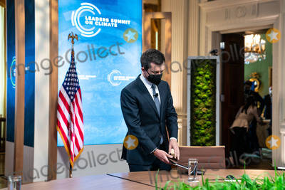 Pete Buttigieg Photo - United States Secretary of Transportation Pete Buttigieg  arrives to the East Room of the White House for the virtual Leaders Summit on Climate in Washington DC on April 23rd 2021 Credit Anna Moneymaker  Pool via CNPAdMedia
