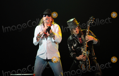 Axl Rose Photo - 24 January 2010 - Hamilton Ontario Canada  Axl Rose and DJ Ashba of Guns N Roses perform on stage at Copps Coliseum in support of Chinese Democracy  Photo Credit Brent PerniacAdMedia