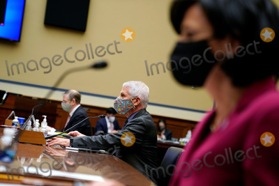Anthony Fauci Photo - Dr Anthony Fauci Director of the National Institute of Allergy and Infectious Diseases at the National Institutes of Health prepares to testify before the US House Select Subcommittee on the Coronavirus Crisis holds a hearing on the Capitol Hill in Washington on Thursday April 15 2021 Credit Amr Alfiky  Pool via CNPAdMedia