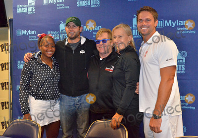 Andy Roddick Photo - 16 October 2012 - Pittsburgh PA - TEAM ELTON (l to r TAYLOR TOWNSEND ANDY RODDICK SIR ELTON JOHN MARTINA NAVRATILOVA and JAN-MICHAEL GAMBILL) pose for a team photo at the Press Conference before the Mylan WTT Smash Hits World Team Tennis Match held at the Petersen Events Center The 20th anniversary edition of Mylan WTTSmash Hits presented by GEICO was one for the record books with the event posting a record 1 million for the Elton John AIDS Foundation with a portion of those proceeds benefitting the Pittsburgh AIDS Task Force Theevent hosted annually by Sir Elton John and Billie Jean King has now raised more the 115 million to support HIV and AIDS prevention and awareness programs since the first Smash Hits was held in Los Angeles in 1993  Photo Credit Jason L NelsonAdMedia
