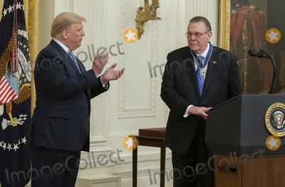 Keane Photo - United States President Donald J Trump left applauds after presents the Presidential Medal of Freedom to US Army General John M Jack Keane (retired) right during a ceremony in the East Room of the White House in Washington DC on Tuesday March 10 2020  Keane is a former Vice Chief of Staff of the US Army and is a Fox News national security analystCredit Ron Sachs  CNPAdMedia