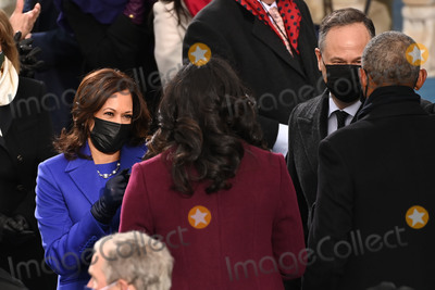 Barack Obama Photo - US Vice President-elect Kamala Harris (L) salutes Former US First Lady Michelle Obama as US Second Gentleman Doug Emhoff (2nd R) meets Former US President Barack Obama before US President-elect Joe Biden is sworn in as the 46th US President on January 20 2021 at the US Capitol in Washington DC - Biden a 78-year-old former vice president and longtime senator takes the oath of office at noon (1700 GMT) on the US Capitols western front the very spot where pro-Trump rioters clashed with police two weeks ago before storming Congress in a deadly insurrection (Photo by Saul LOEB  POOL  AFP)AdMedia