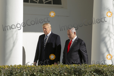 Benjamin Netanyahu Photo - United States President Donald J Trump and Benjamin Netanyahu Prime Minister of the State of Israel walk through the colonnade of the White House in Washington DC US on Monday January 27 2020Credit Stefani Reynolds  CNPAdMedia