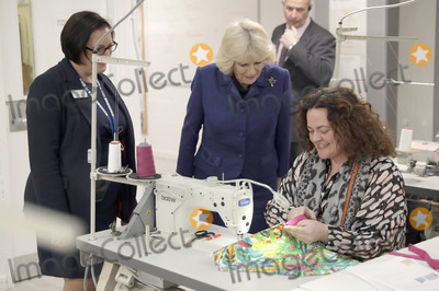 Train Photo - 06022020 - Camilla Duchess of Cornwall speaks with a prisoner flanked by governor Natasha Wilson at Making for Change a fashion training and manufacturing unit during a visit to Her Majestys HM Prison Downview in Sutton south London During the visit to the womens prison Thursday the Duchess met staff and inmates and learnt about the prisons rehabilitation programmes Photo Credit ALPRAdMedia