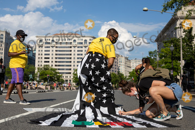American Flag Photo - ZaK the designer behind Jon Marc Collection wears an American flag skirt which was signed by protestersduring a march against police brutality and racism in Washington DC on Saturday June 6 2020Credit Amanda Andrade-Rhoades  CNPAdMedia