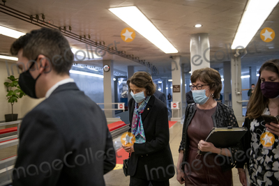 Senator Dianne Feinstein Photo - United States Senator Dianne Feinstein (Democrat of California) left and United States Senator Susan Collins (Republican of Maine) right make their way through the Senate subway for a vote at the US Capitol in Washington DC Tuesday March 16 2021 Credit Rod Lamkey  CNPAdMedia