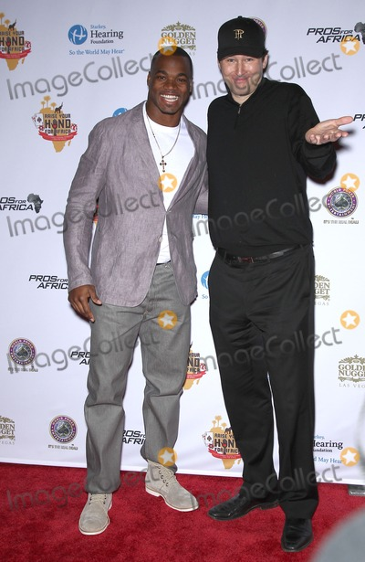 Adrian Peterson Photo - 19 February 2011 - Las Vegas Nevada - Adrian Peterson Phil Helmuth Celebrities Poker Pros and Football Stars Raise Their Hand For Africa Texas Holdem Charity Tournament at the Golden Nugget Hotel and Casino Photo MJTAdMedia