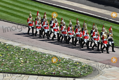 Prince Photo - Photo Must Be Credited Alpha Press 073074 17042021Members of Household Cavalry march during the funeral of Prince Philip Duke of Edinburgh at St Georges Chapel in Windsor Castle in Windsor Berkshire No UK Rights Until 28 Days from Picture Shot Date AdMedia